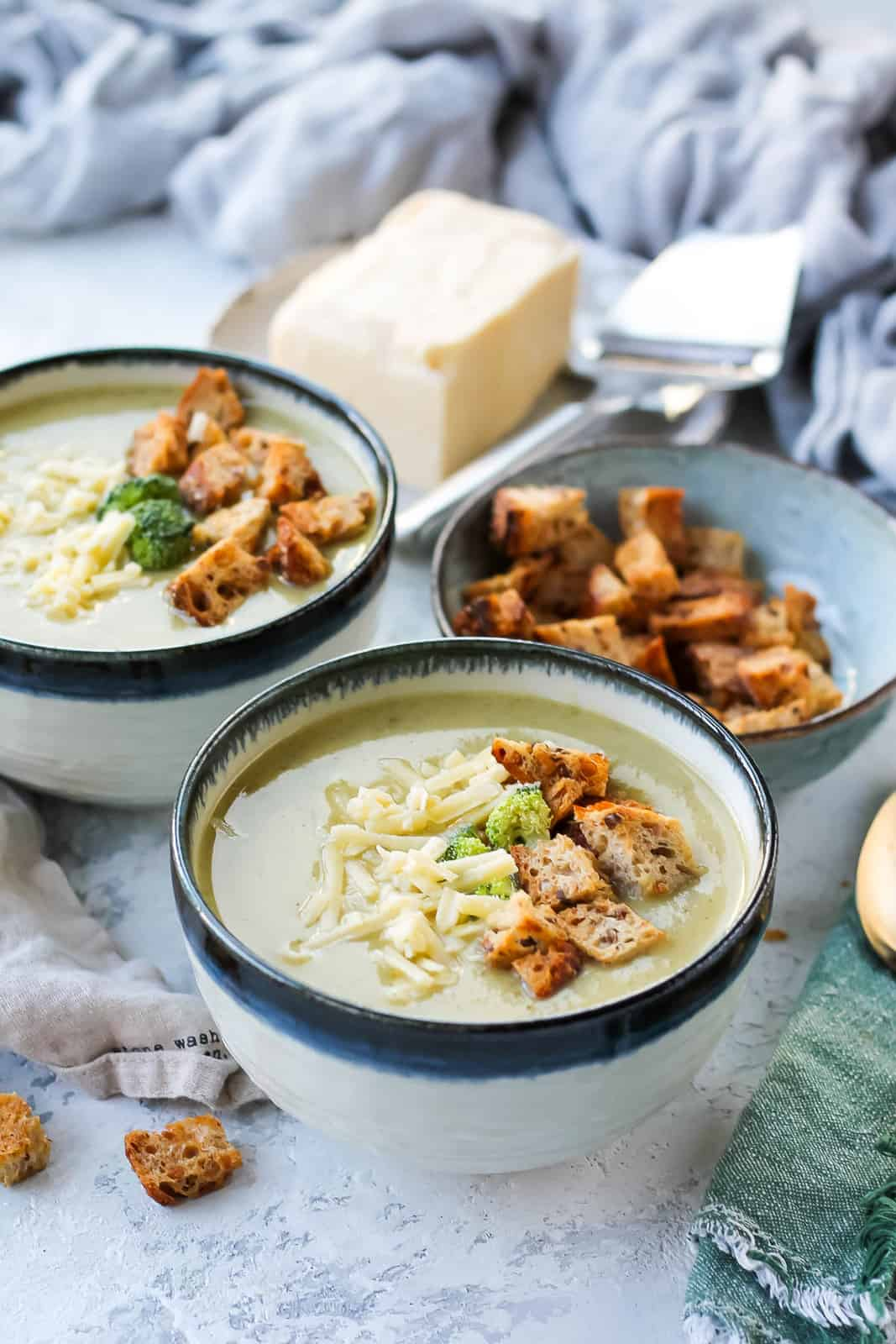 a bowl of instant pot broccoli cheddar soup topped with croutons