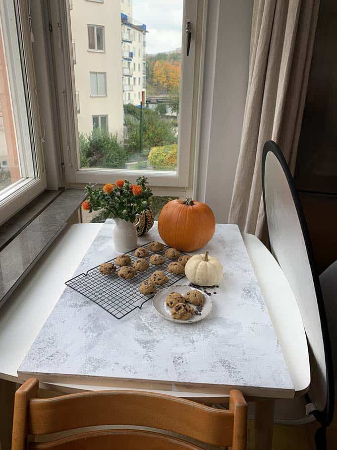 a photo backdrop with pumpkin and cookies on it